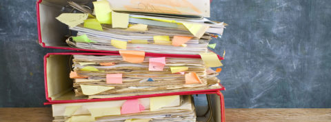 stack of messy file folders and documents,free copy space